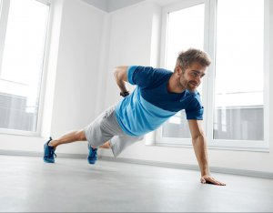 man doing one-handed push-up